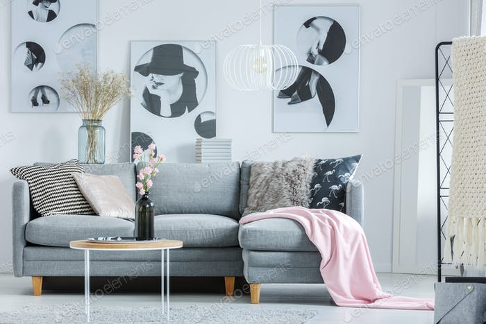 Pink blanket on grey sofa
