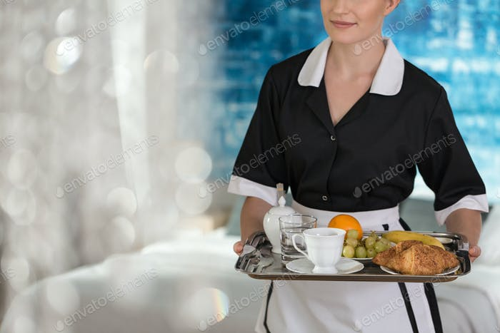 Maid with tray with fruit