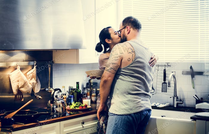 Wife kissing husband at the kitchen