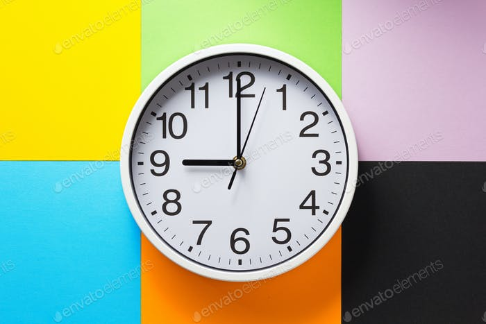 wall clock at abstract colorful paper