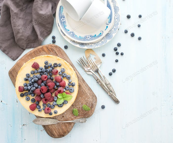Cheesecake with fresh raspberries and blueberries