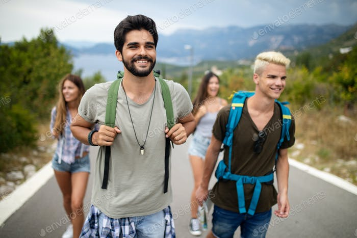 Group of happy friend traveler walking and having fun. Travel lifestyle and vacation concept