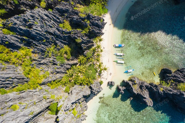El Nido, Palawan, Philippines, top down bird eye aerial view of boats and cliffs rocky mountains
