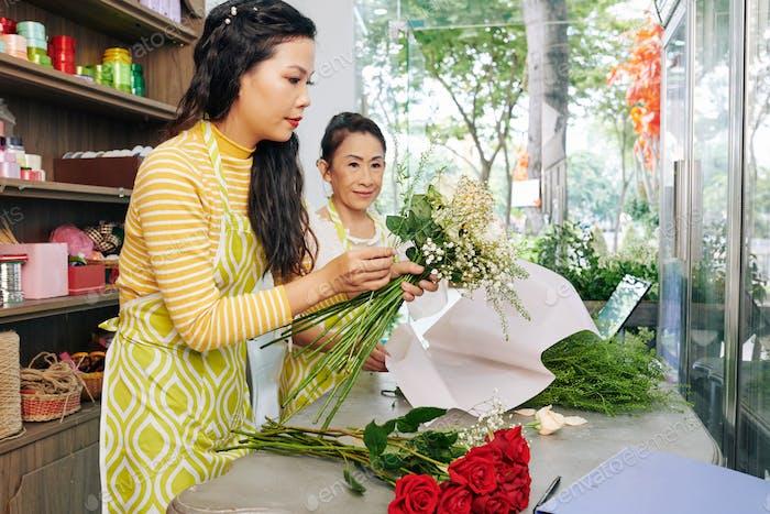 Florist making fist bouquet