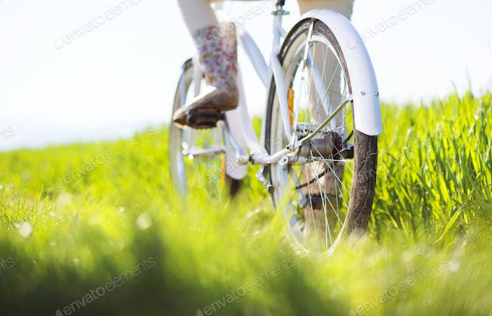 Thumbnail for Detial of young woman with bike