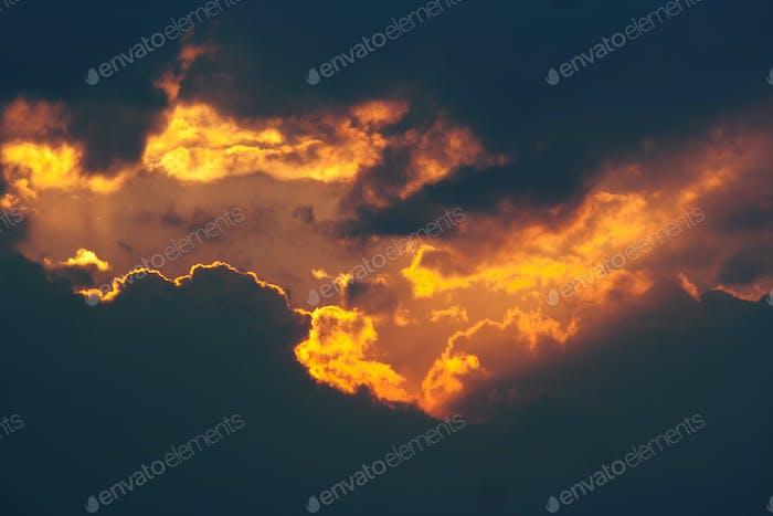 Fiery break in the dark clouds
