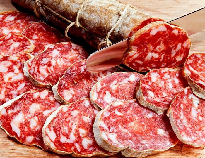 Sliced fresh spicy Italian salami