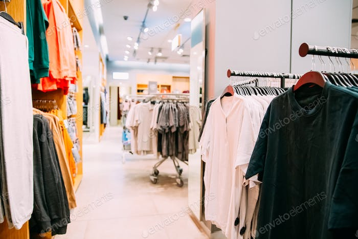 Many Male One-colour T-shirt On Hanger In Store Of Shopping Cent