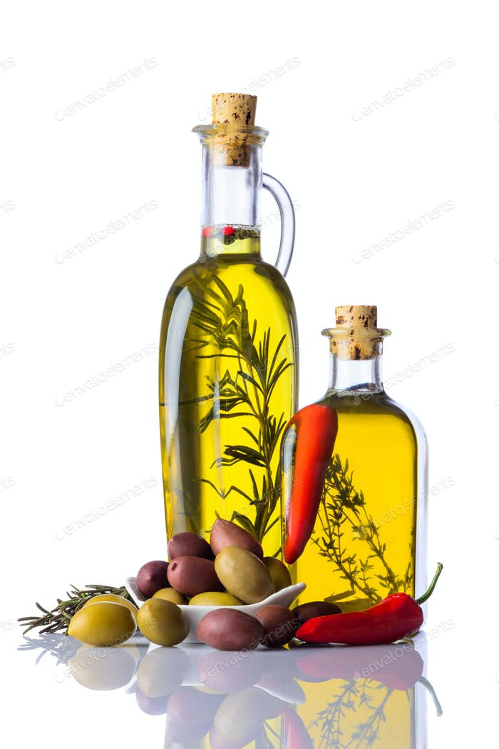 Bottles of Olive Oil with Pepper and Herbs on White