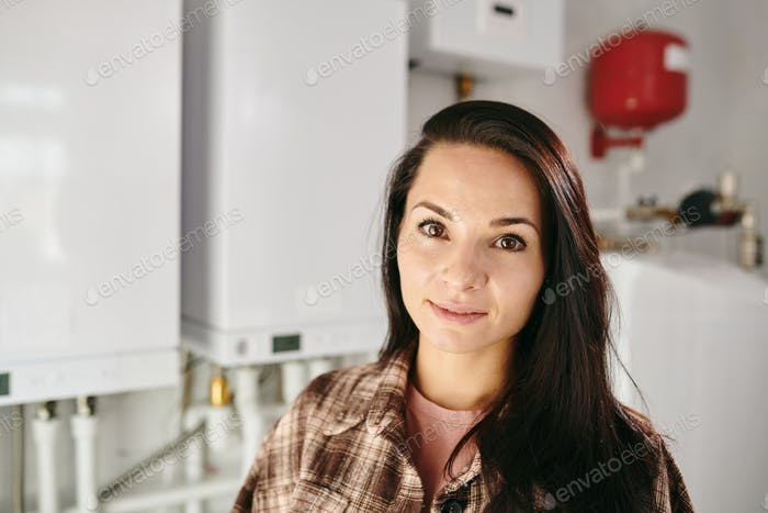 Young Caucasian brunette female looking at camera