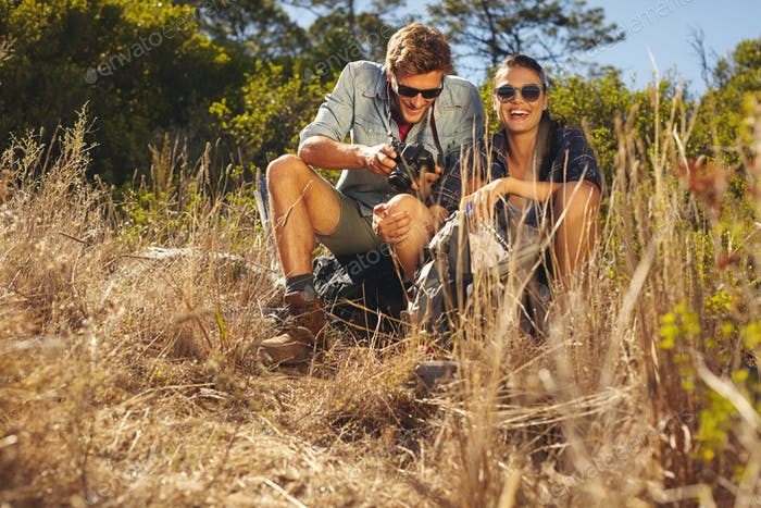 Young couple on hiking trip taking a break