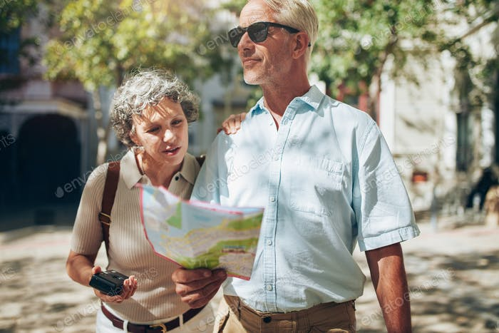 Mature couple using a map on a vacation
