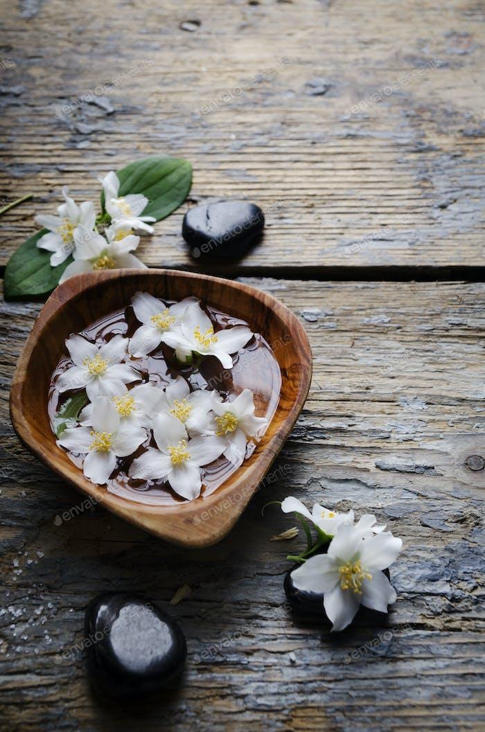 Jasmine flowers and spa stones