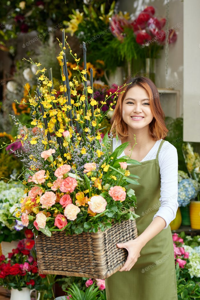 Florist with basket of flowers