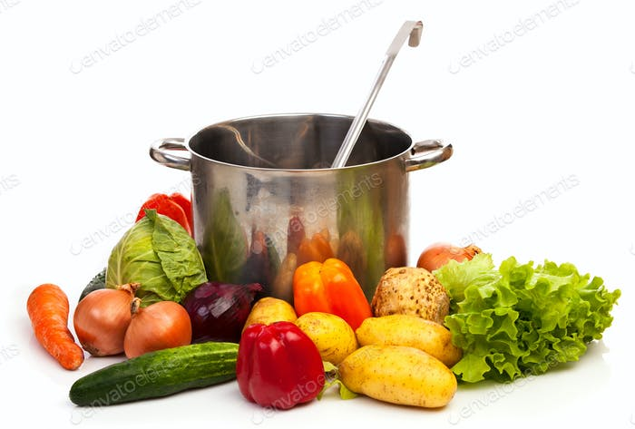 Set of fresh vegetables,casserole and ladle over white