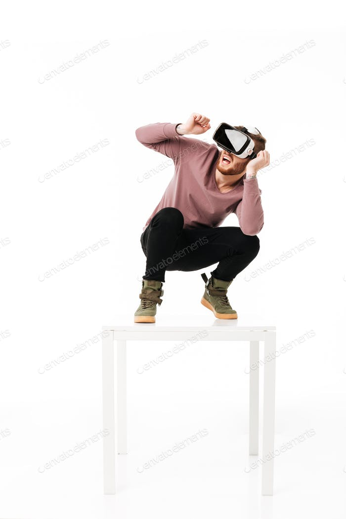 Scared boy using visual reality glasses isolated