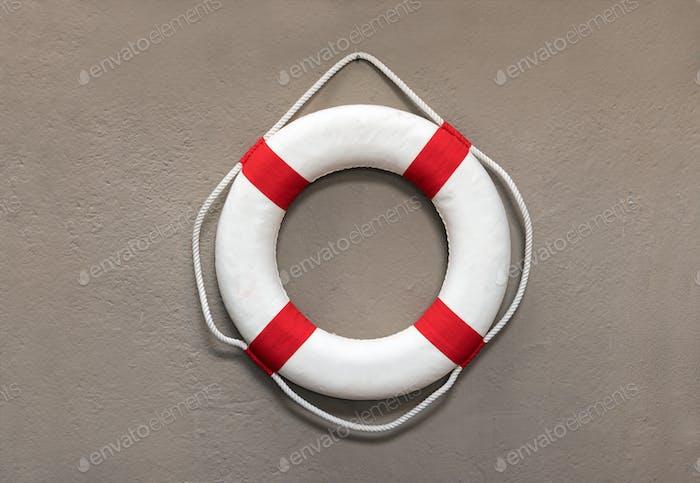 Circular life preserver or lifebuoy on a wall
