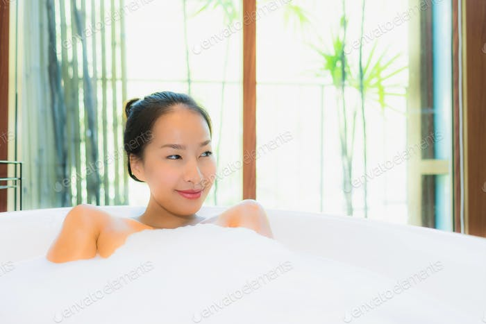 Portrait beautiful young asian woman in the bathtub for take a b