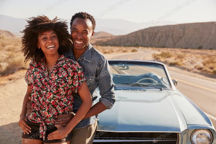Young black couple on road trip having a roadside stop off