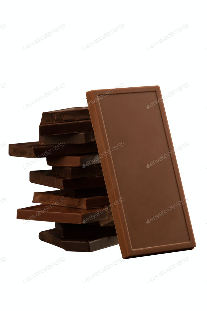 Square shaped chocolate pieces isolated on white