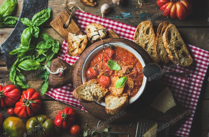 Italian tomato and garlic soup with basil, bread, Parmesan cheese