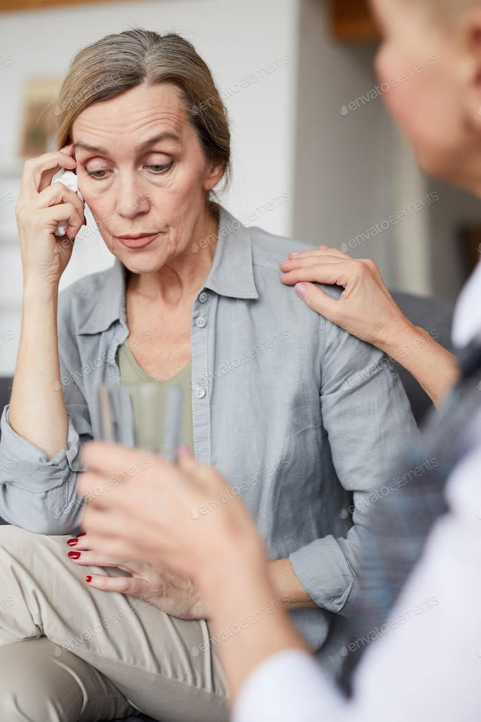 Crying Mature Woman in Therapy Session