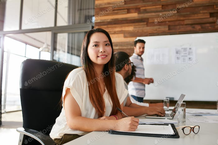 Young woman attending a business presentation