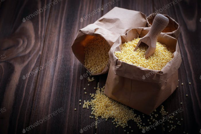 Millet grain in paper bags