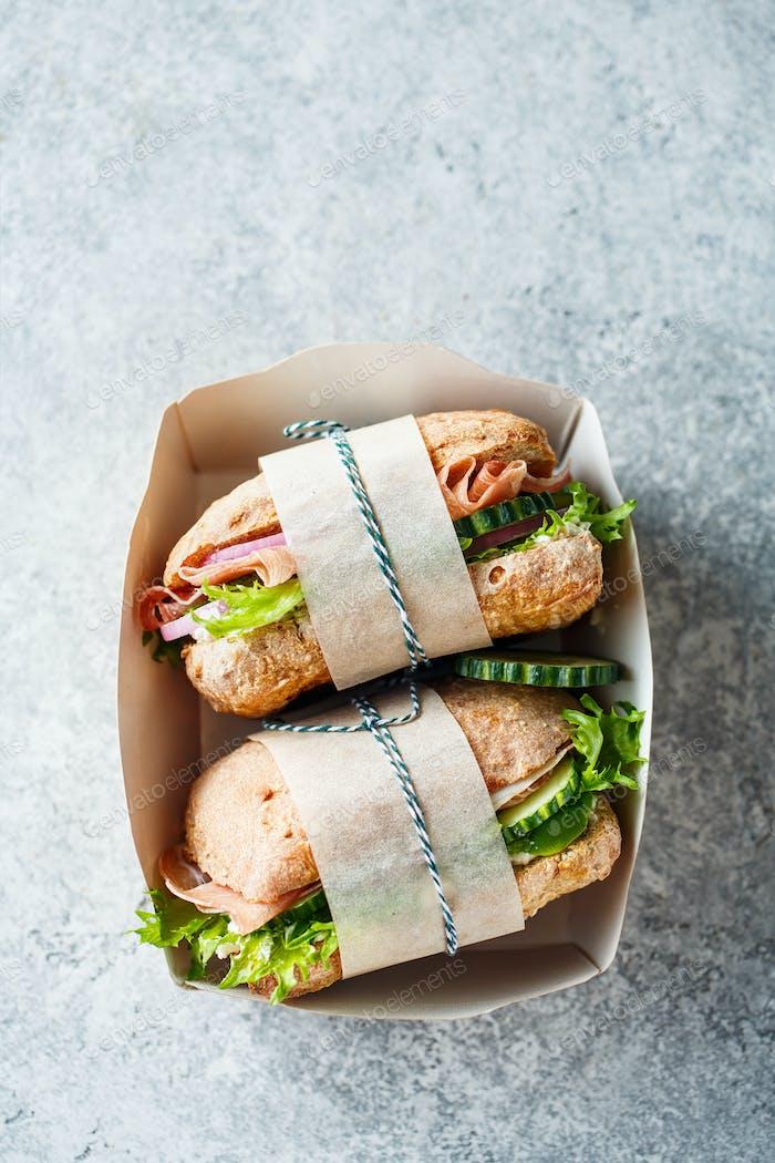 Takeaway sandwiches in paper box