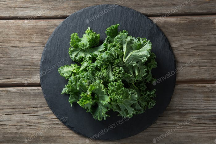 Overhead view of kale on plate over table
