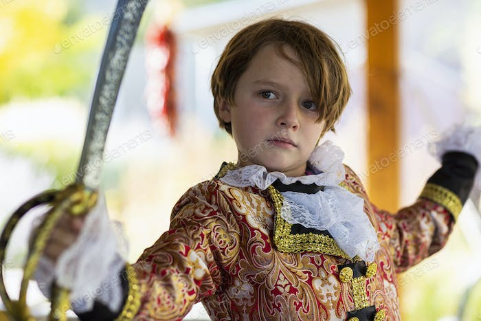Young boy dressed as a pirate.