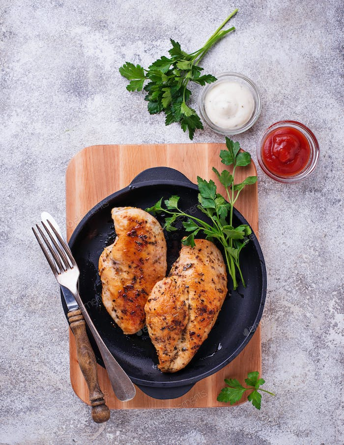 Grilled chicken breast or fillet on iron pan