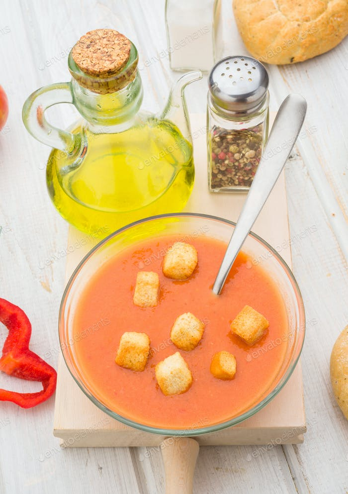 aerial view of gazpacho soup with croutons in round glass bowl