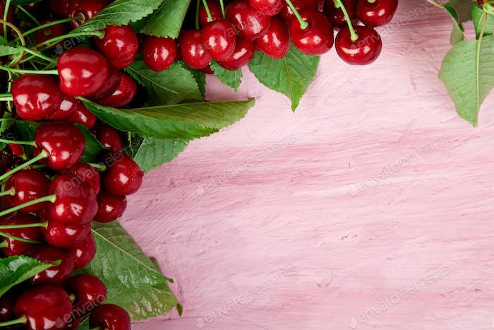 Ripe cherry berries and cherry  leaf