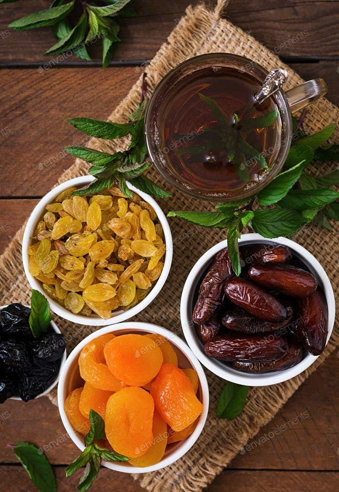 Mix dried fruits  and nuts, and traditional Arabic tea. Ramadan (Ramazan) food. Top view
