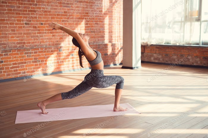 Attractive girl practicing yoga
