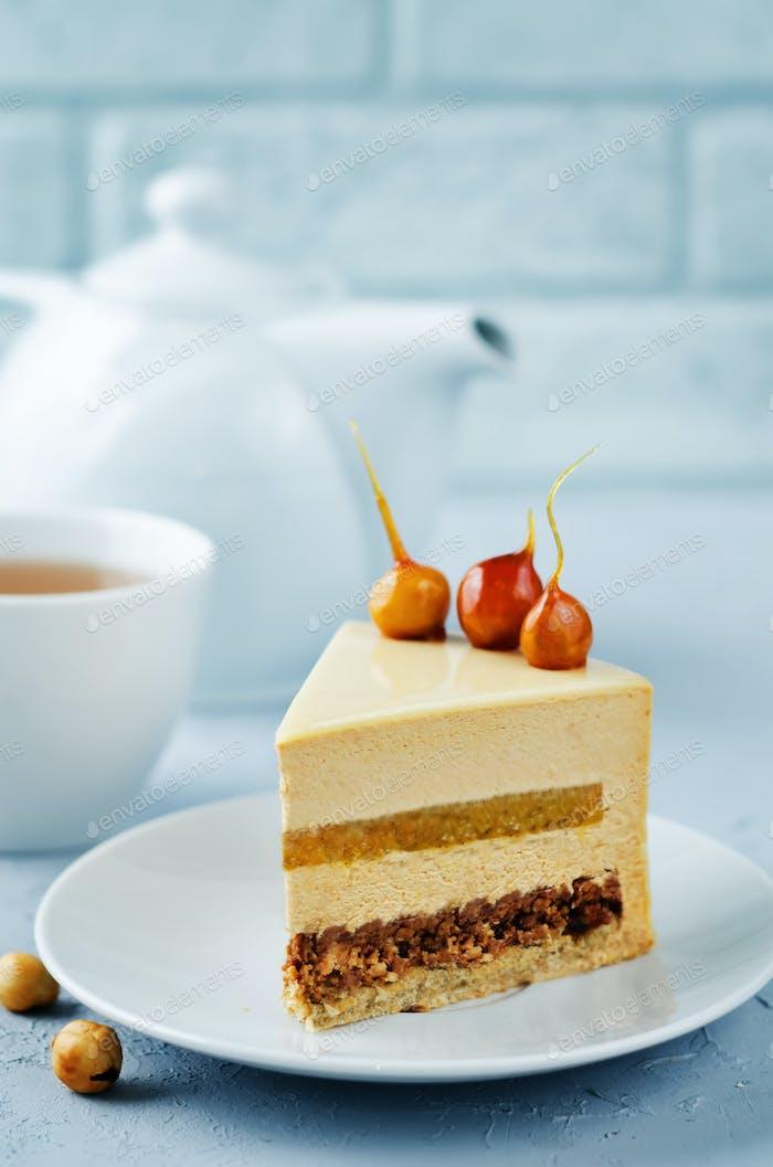 Caramelized white chocolate dried apricots hazelnut mousse cake