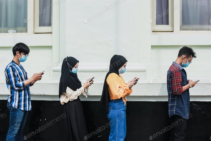 People standing in queue with distance