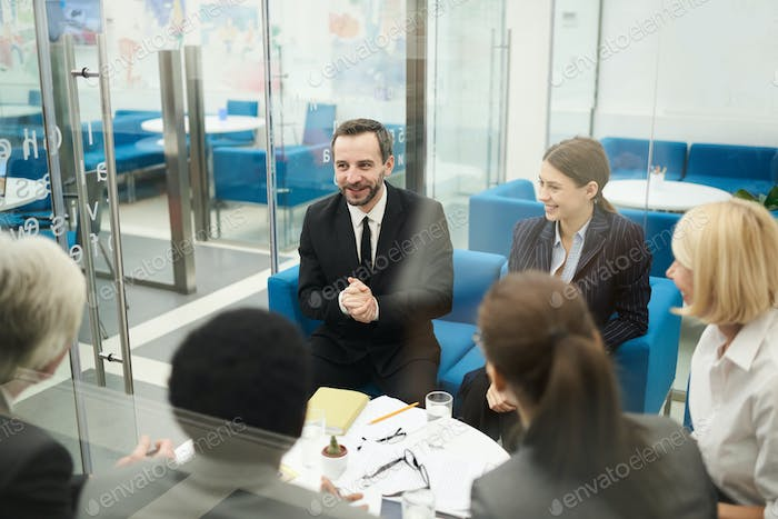 Cheerful People in Business Meeting