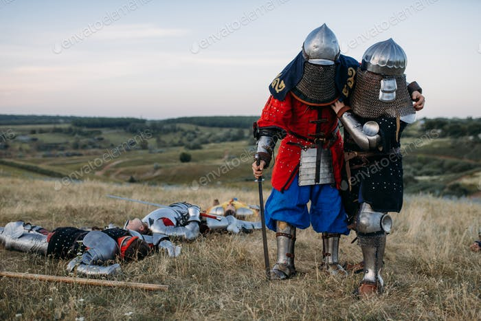 Wounded medieval knights after great battle