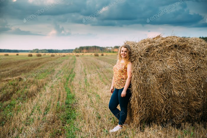 Portrait Beautiful Plus Size Young Woman Standing Near Hay Bale