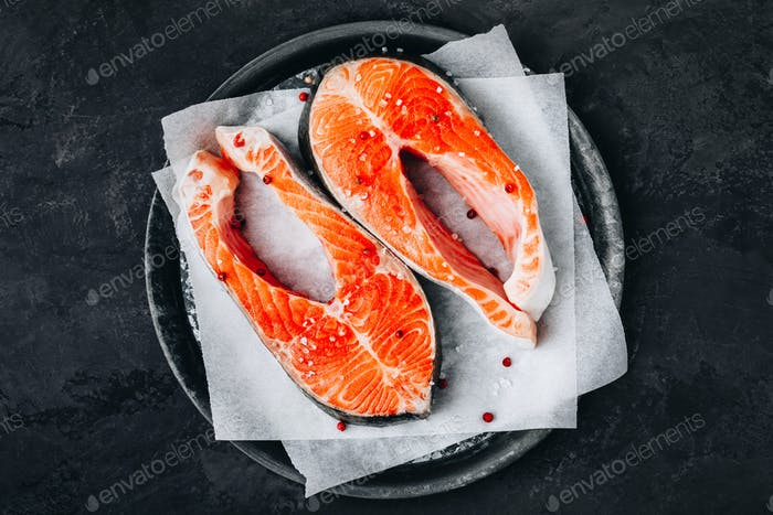Fresh raw Salmon Steaks prepared for cooking.