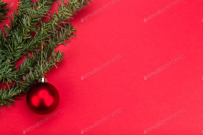 Simple red Christmas background with fir tree and ornaments.