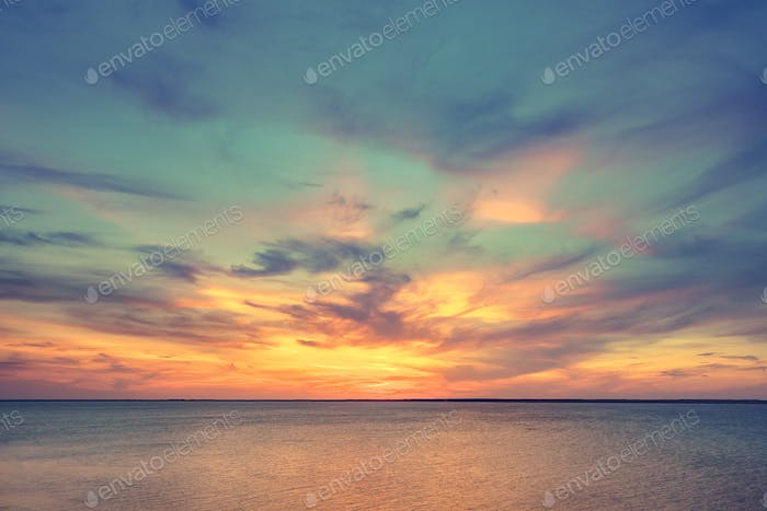 Aerial panoramic view of sunset over ocean