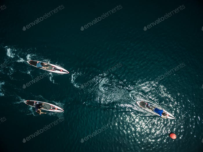Aerial shot of a group of people on paddleboards.