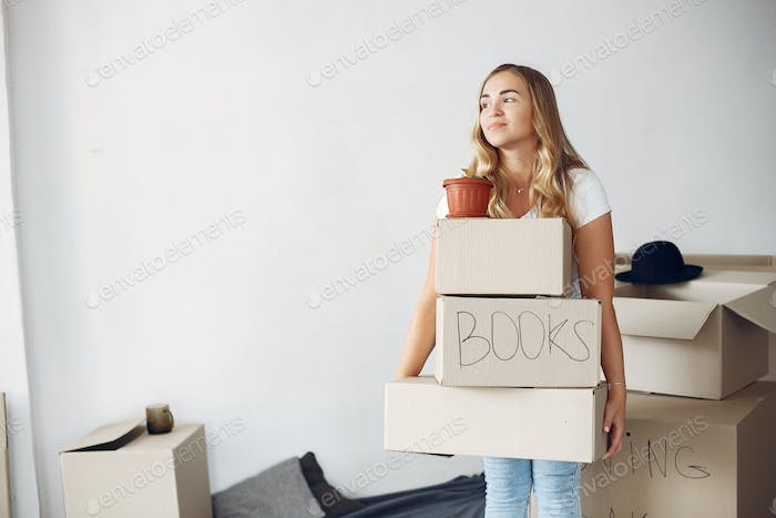 Woman moving and using a boxes