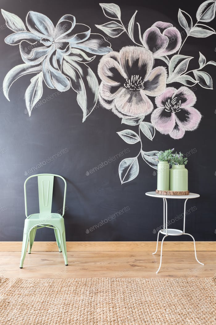 Floral motif on blackboard wall