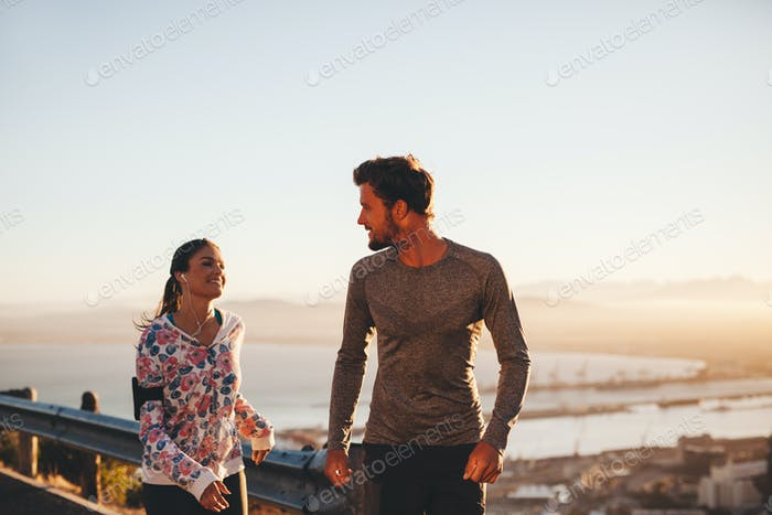 Fit young couple jogging outdoors