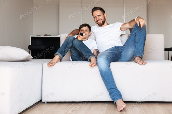 Handsome bearded man indoors at home with his son
