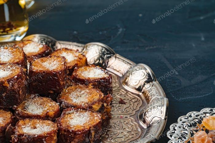Turkish arabic desserts on silver plate close up
